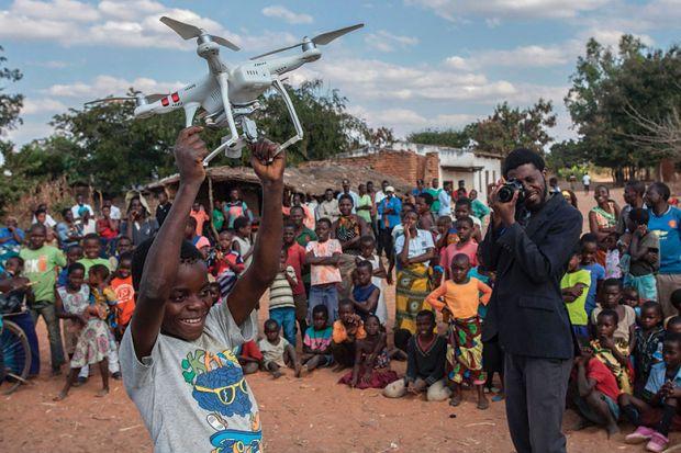 Boy holding drone