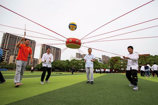 Students play stress relief games in Hai'an City, Jiangsu Province, China