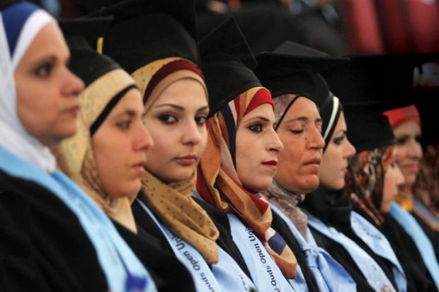 Palestinian students at Al-Quds Open University graduation ceremony