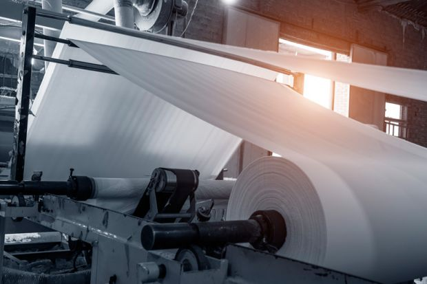 Paper being processed in paper mill