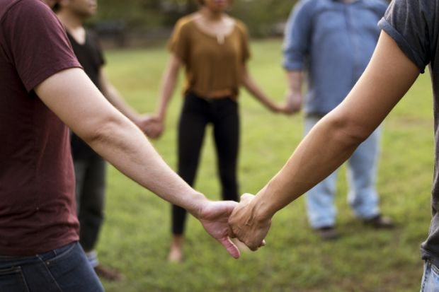 People hold hands in a circle