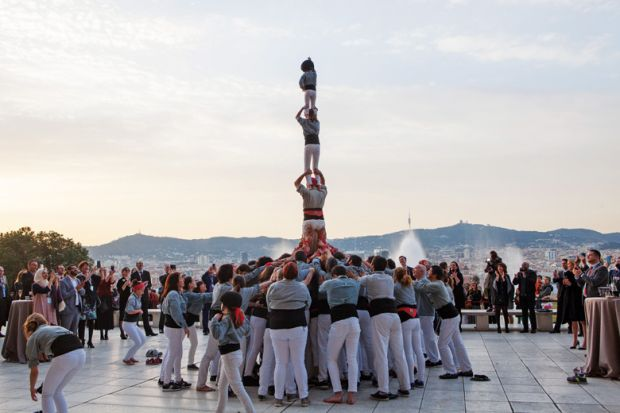 People forming human tower, Young Universities Summit 2016
