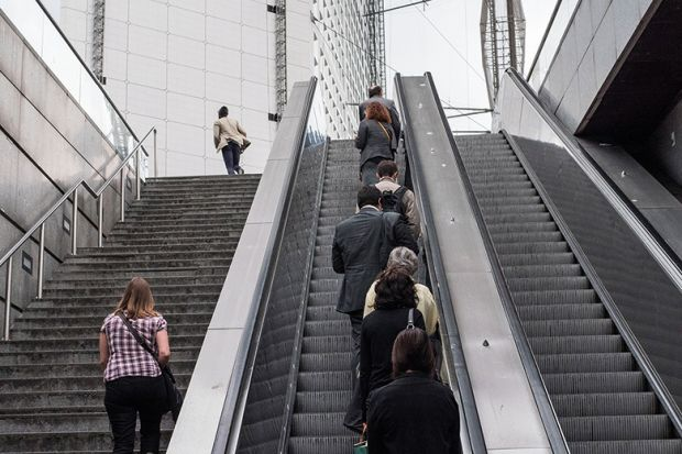 people going up escalator