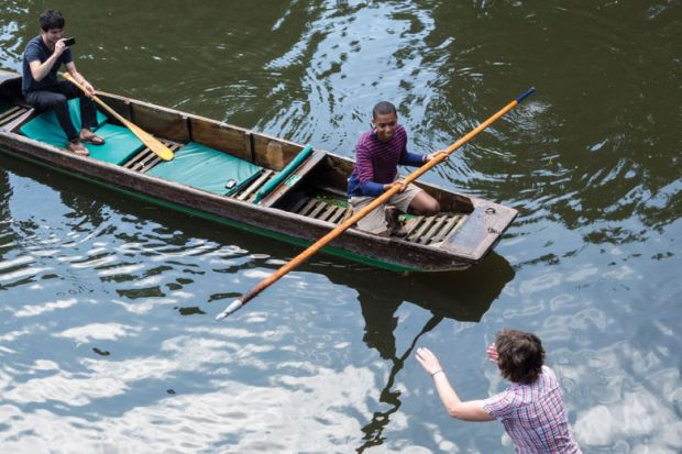People on boats punting on River Cam, Cambridge