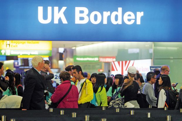 People queuing at UK border, Heathrow Airport, London