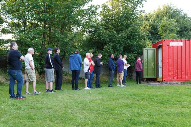 People queuing for toilet