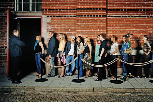 People queuing outside nightclub