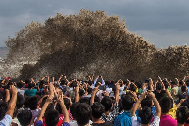 People taking photos of tidal waves, Typhoon Usagi