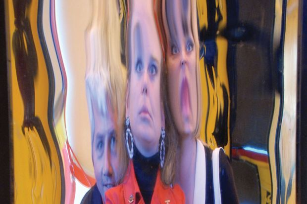 People's faces distorted in hall of mirrors reflection