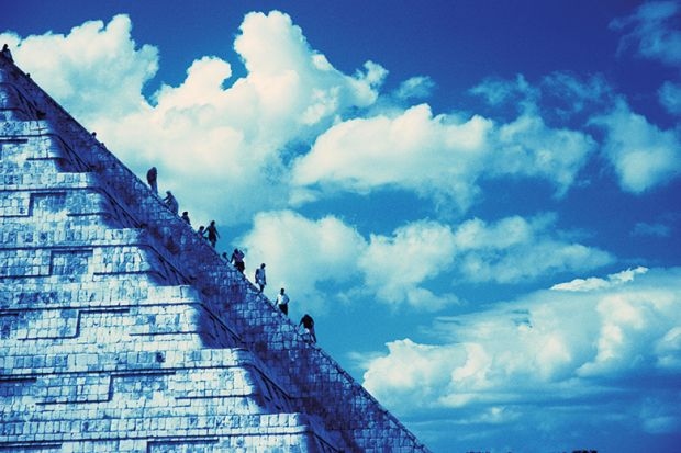 People climbing Aztec-style temple
