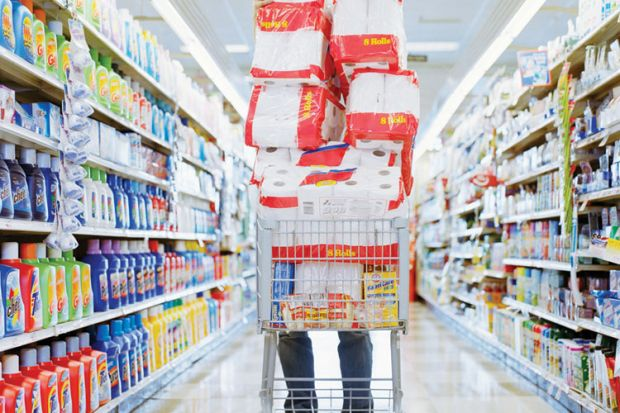 Person pushing overloaded shopping trolley