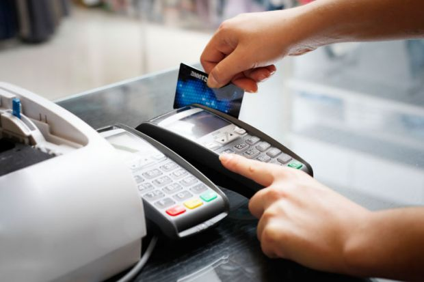 Person swiping credit card instore