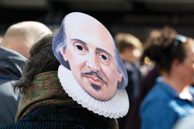 A person wearing a Shakespeare mask