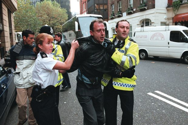 Peter Tatchell is arrested in London for protesting against Robert Mugabe