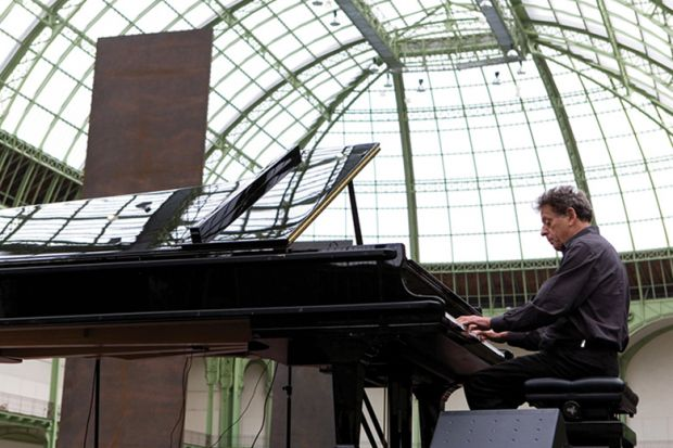 Philip Glass playing the piano