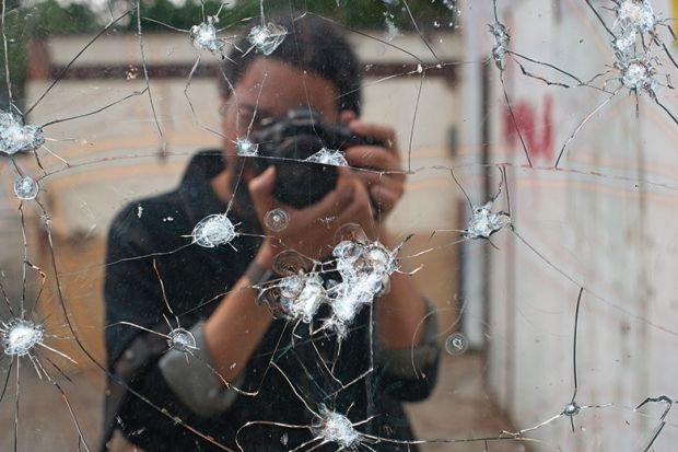 Photo of bullet holes in mirror