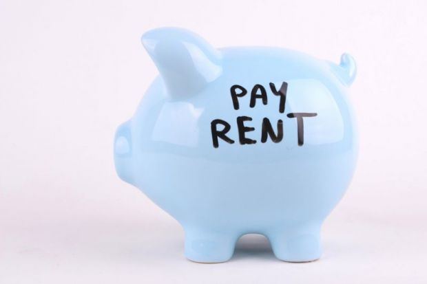 Piggy bank saying 'pay rent'