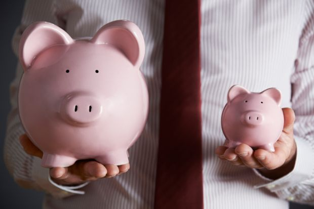 Man holding two piggy banks