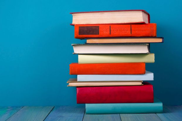 Pile of books against blue background