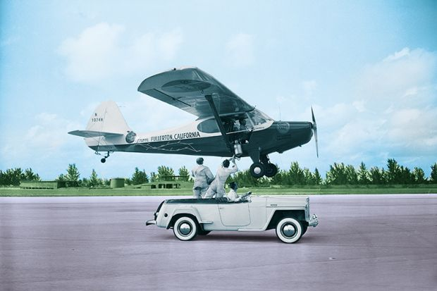 car and plane on runway