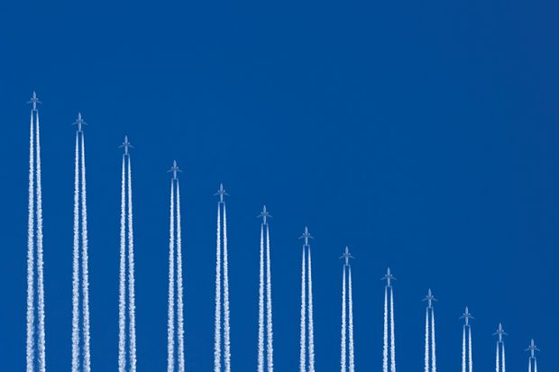 row of planes flying vertically to depict international study