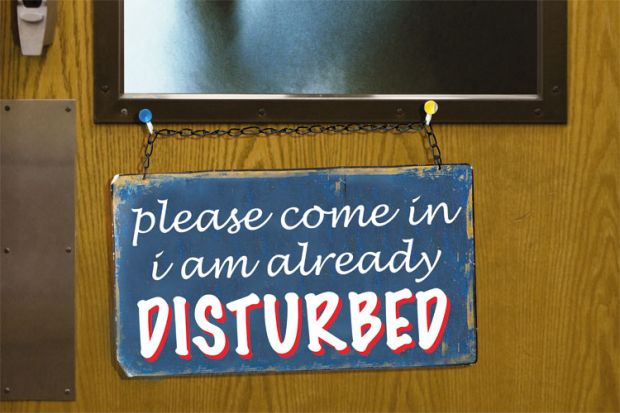 'Please come in, I am already disturbed' sign on door