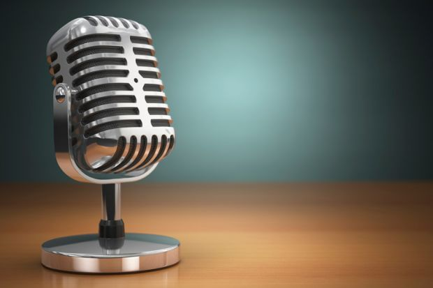 Podcast (old microphone placed on office desk)