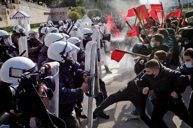Clashes between demonstrators and riot police during the university students protest against the government-promoted university police in universities in Athens, on February 10, 2021.