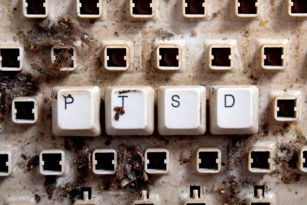 Post-traumatic stress disorder (PTSD) spelled on dirty, broken keyboard keys