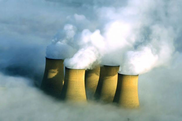 Power station chimneys engulfed in fog
