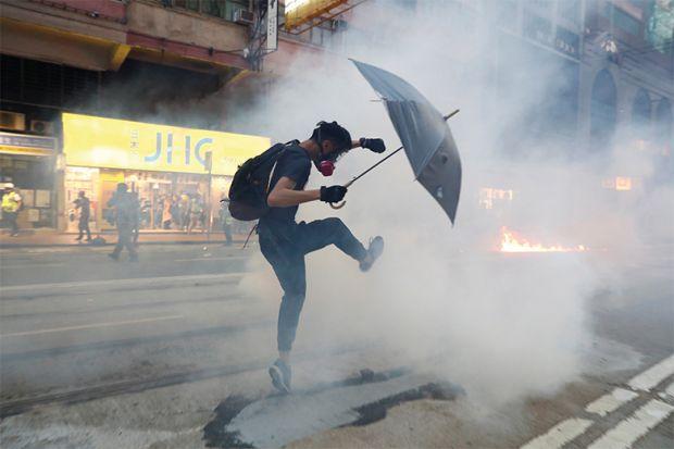 Hong Kong protester with umbrella