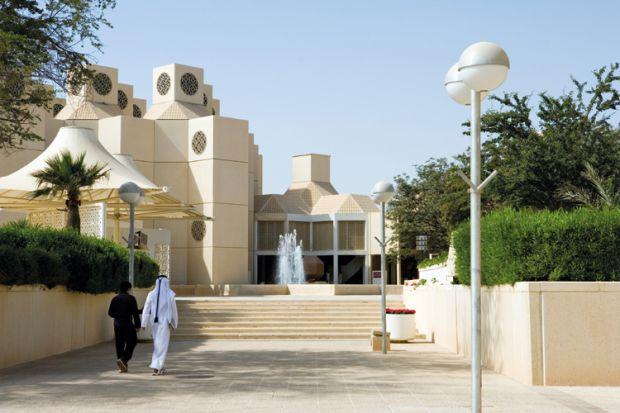 Qatar University students walking on campus