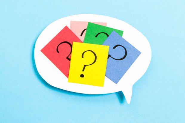 Question marks inside a speech bubble