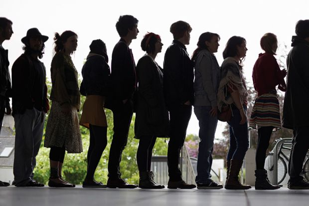 Queue of people in silhouette