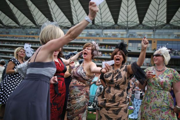Racegoers celebrate win, Royal Ascot, England