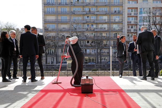 Hoovering a red carpet