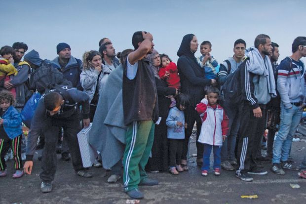 Refugees cross into Hungary from Serbia