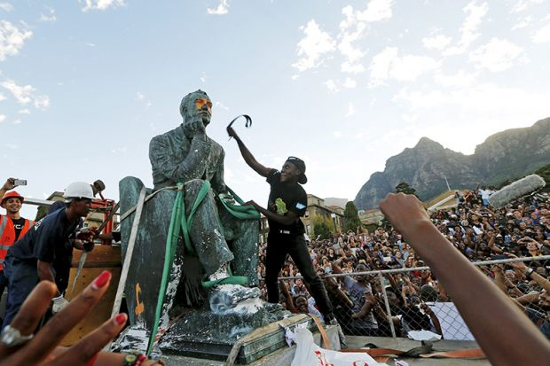 Activists deface a statue of Cecil John Rhodes at UCT