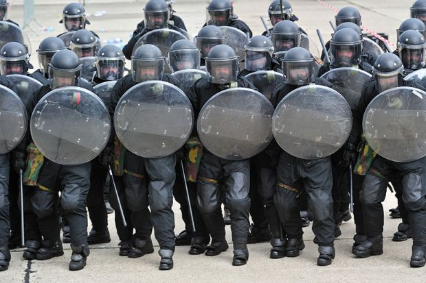 Riot police with shields