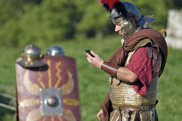 Roman centurion with mobile phone