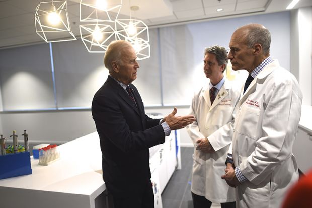 Joe Biden (L) meets with (C-R) Dr. Bruce Levine and Dr. Carl June, while touring the University of Pennsylvania, Perelman School of Medicine and Abramson Cancer Center in Philadelphia, Pennsylvania January 15, 2016.