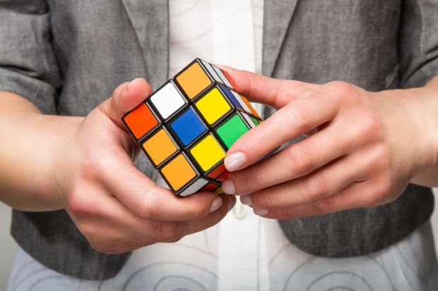 Rubik's Cube puzzle illustrating article about changes to students loans system in the UK