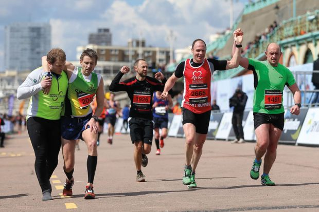 Runners crossing the finish line, Brighton Marathon 2016