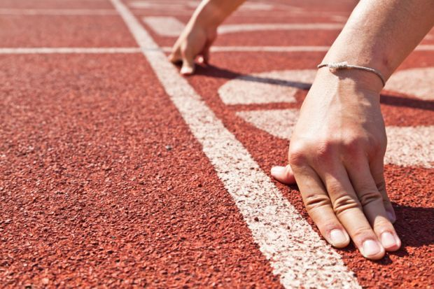Runner's hands placed in race starting position