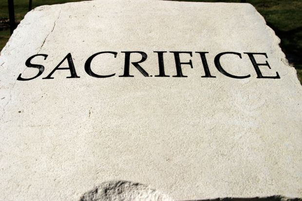 'Sacrifice' engraved on stone tablet