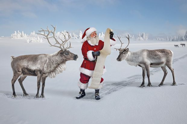 Santa checking list with reindeer