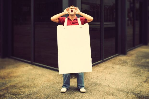 Screaming man wearing sandwich board in street