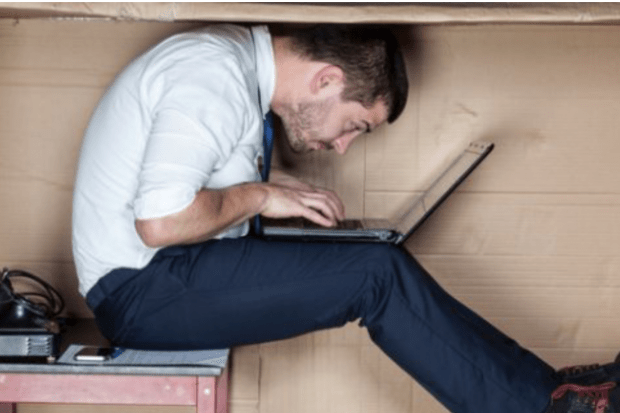 Man cramped in a box, cropped