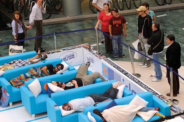 Students sleeping on sofas