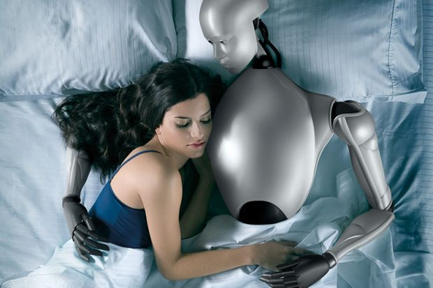 Sex robot. Woman in bed with robot